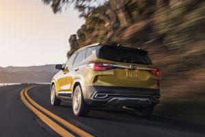 rear view of a yellow 2021 Kia Seltos