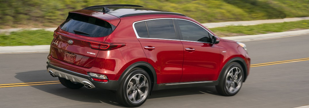 side view of a red 2021 Kia Sportage