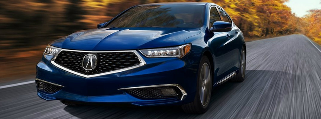 Blue 2019 Acura TLX driving on empty road in autumn