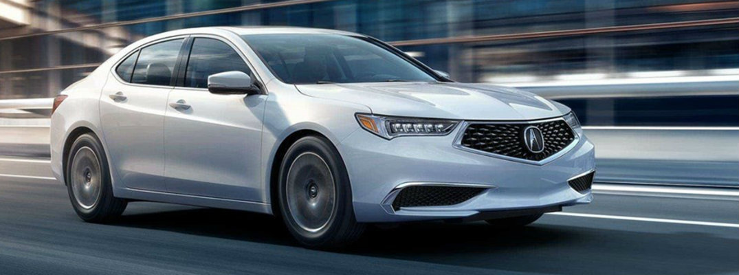 White 2019 Acura TLX driving on city road