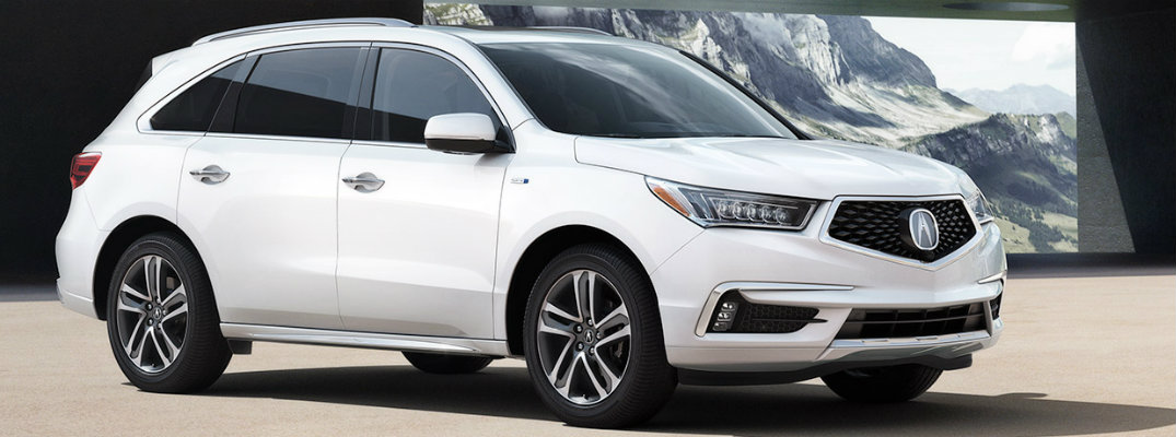 White 2019 Acura MDX parked in building overlooking mountain