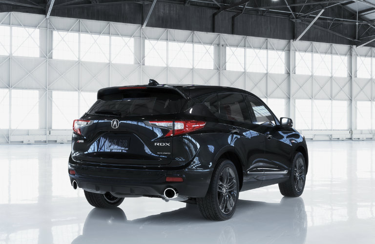Rear shot of blue 2019 Acura RDX parked in white room