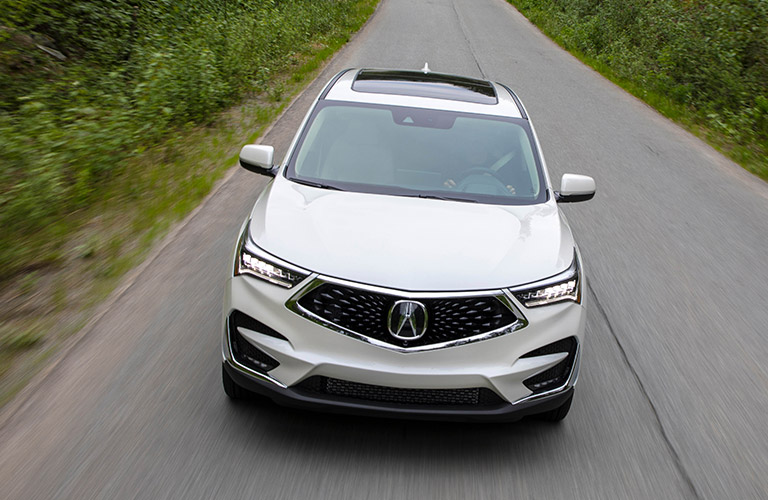 Overhead view of 2019 Acura RDX driving on empty country road