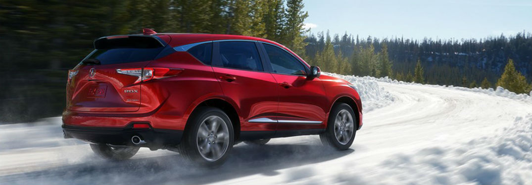 Rear passenger side exterior view of a red 2019 Acura RDX