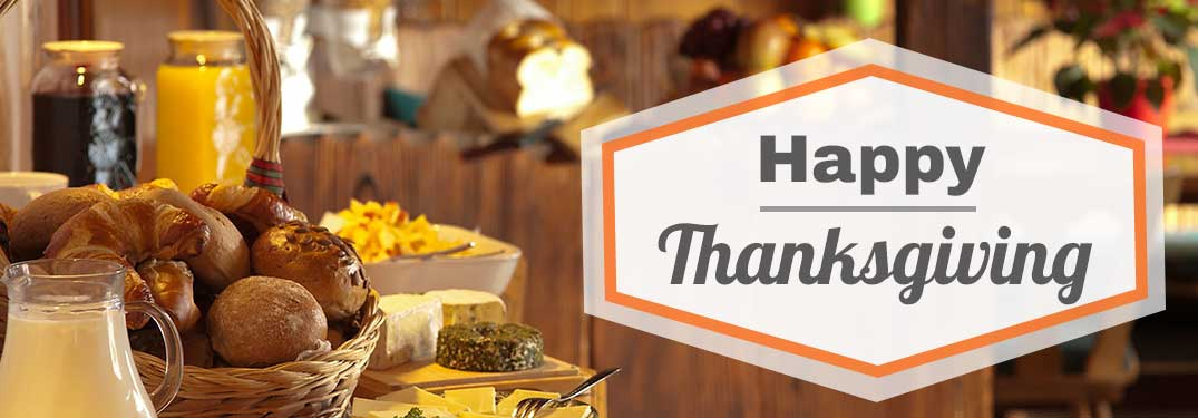"""View of the Thanksgiving dinner spread with """"Happy Thanksgiving"""" sign"""