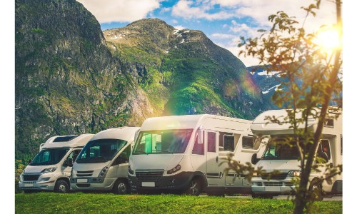 Line up of glimmering RVs