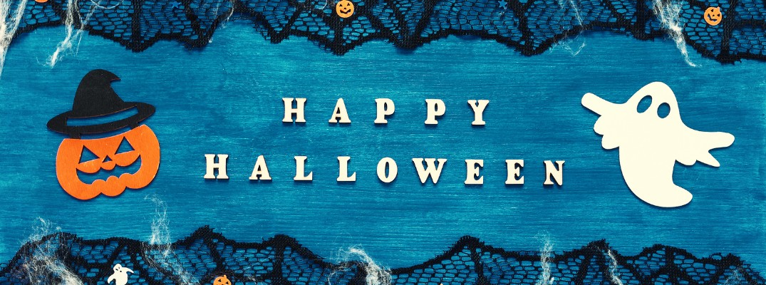 "Blue Halloween graphic with the text ""Happy Halloween!"""