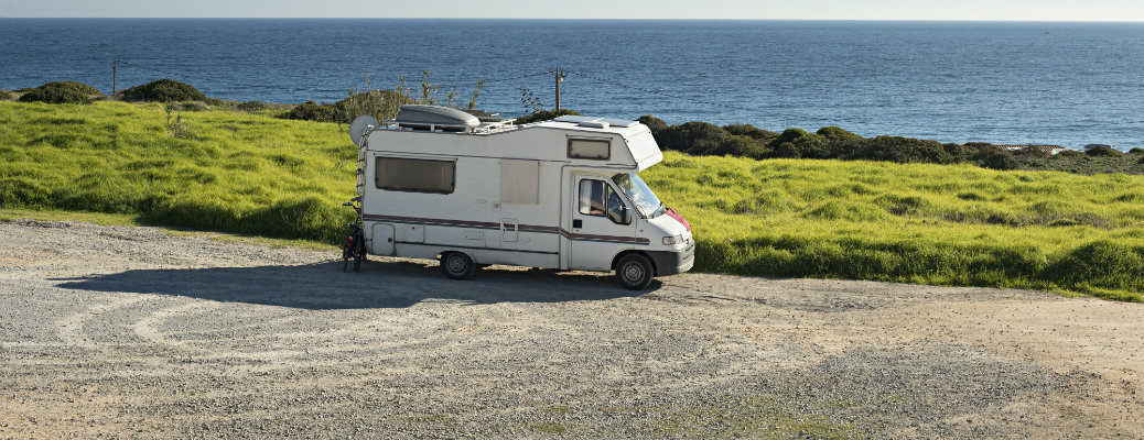 RV by the beach and grass