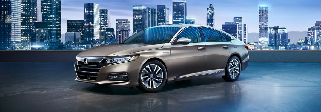 2018 accord hybrid touring gray with blue lit city background