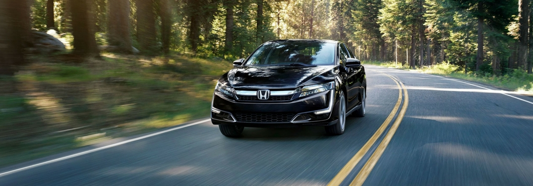 2018 honda clarity plug-in hybrid driving through a forest