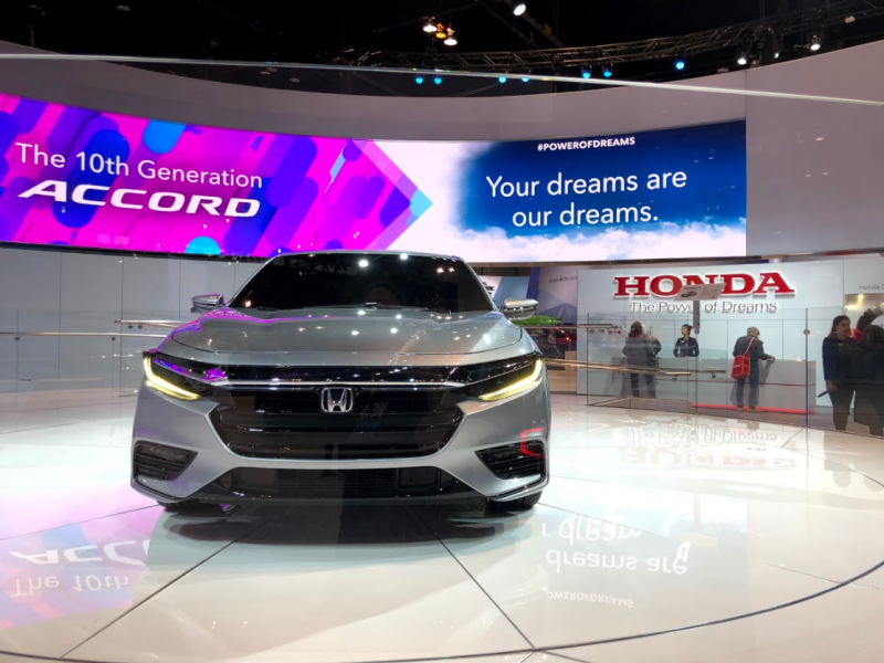 front of the 2019 Honda Insight Prototype at the Chicago Auto Show