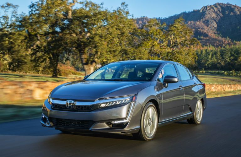 full view of the 2018 Honda Clarity Plug-In Hybrid parked on a country road