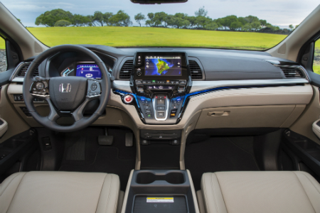 front interior of 2019 honda odyssey including steering wheel and infotainment system