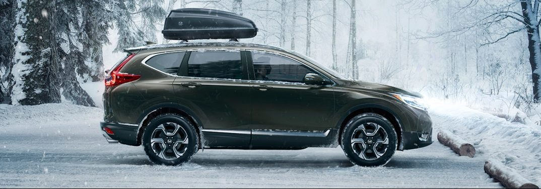 profile view of the Honda CR-V in the snow