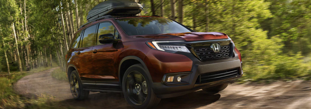 2019 Honda Passport driving on wooded trail