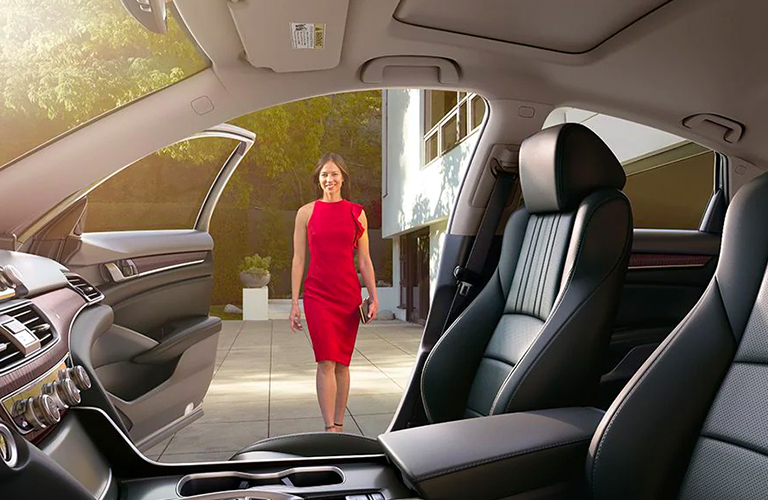 Woman in a red dress approaches the gaping passenger door of a 2020 Honda Accord.