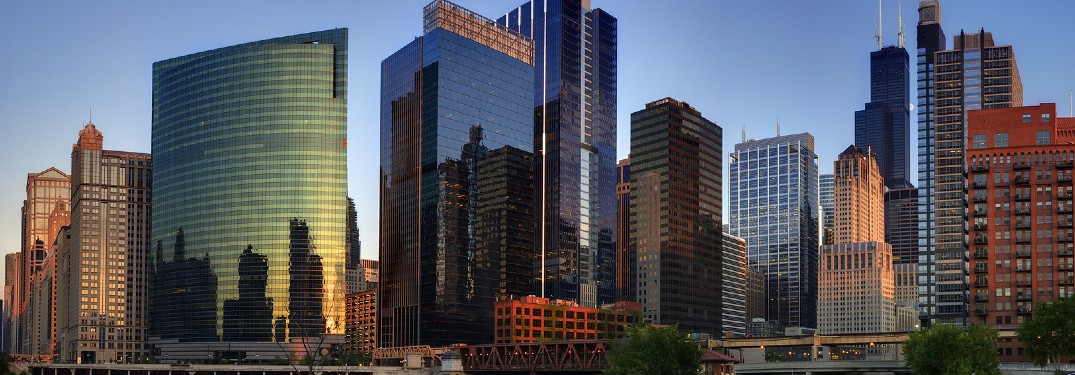 Several sleek glass buildings are seen in Chicago.