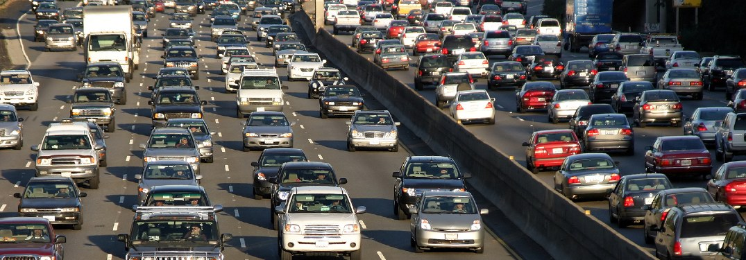 Many vehicles fill a highway in both directions.