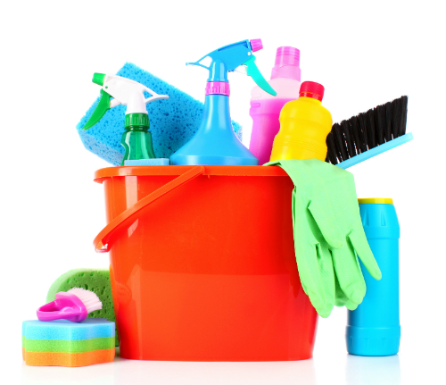 A variety of cleaning supplies in and around a red bucket.
