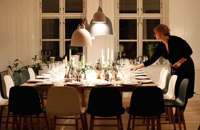 Woman setting the table for Thanksgiving dinner