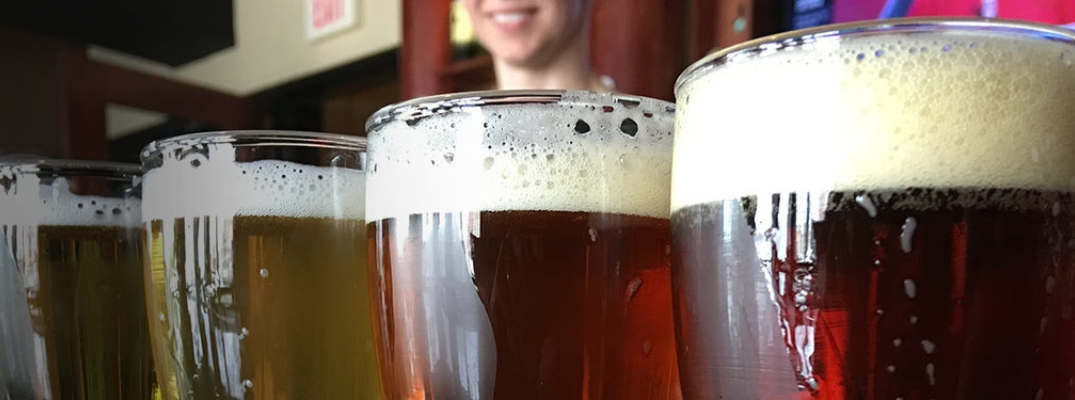 Closeup view of four pints filled with different beers