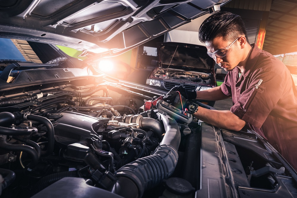 Auto Mechanic Checking Engine