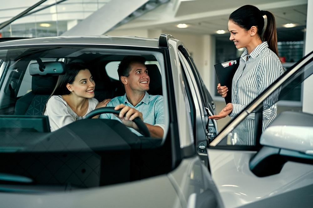 Couple at car dealership