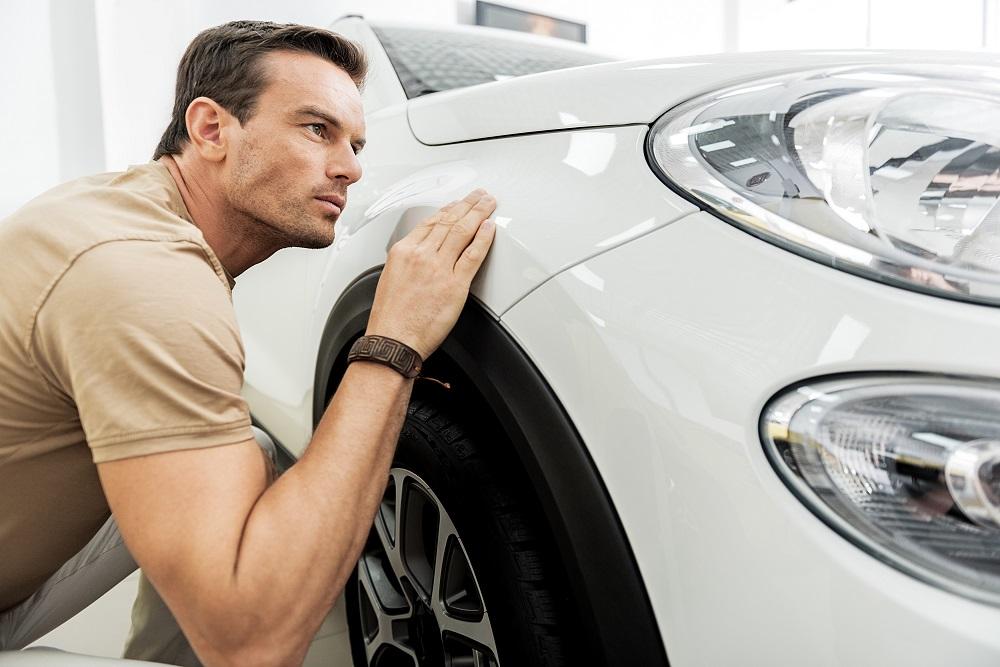 Inspecting car exterior