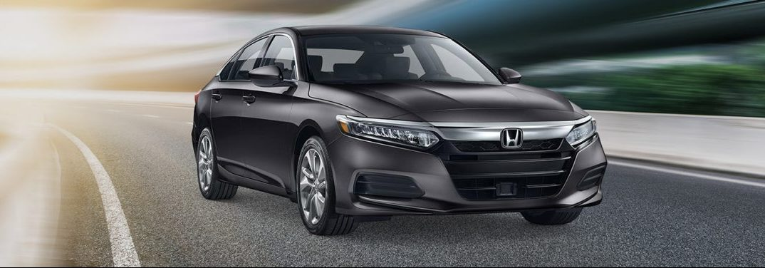 Metallic 2019 Honda Accord cruises around a corner on a track. Is a CD player inside?