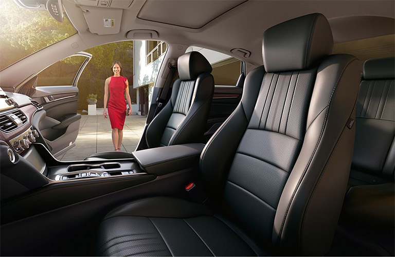 Woman in a red dress approaches the open interior of a 2019 Honda Accord.