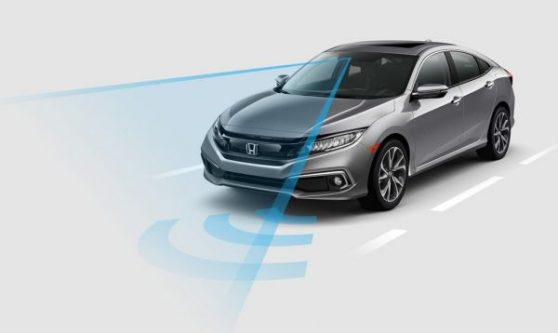 A Honda sedan emits a blue safety ray to detect danger in a simulation.
