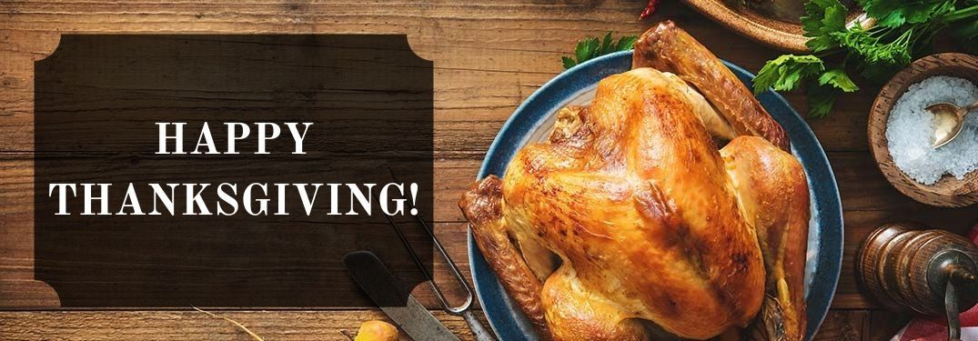 Thanksgiving Turkey on a Table with Black Text Box and White Happy Thanksgiving! Text