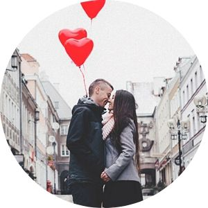 Couple Kissing on a Street with a Red Heart Balloon