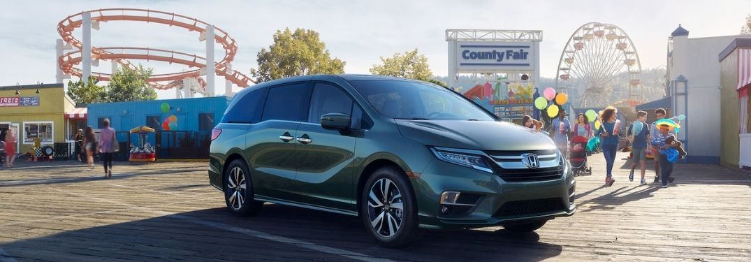 Green 2020 Honda Odyssey with a County Fair in the Background