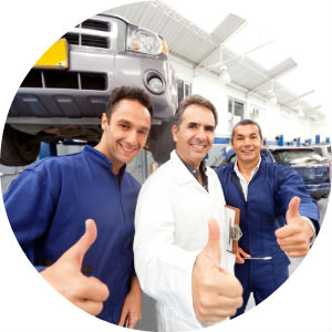 Three Mechanics in a Garage with Thumbs Up