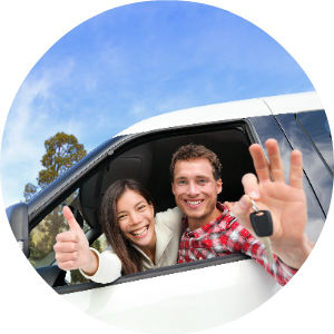 Happy Couple in a New Car Holding Keys