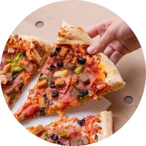 Close Up of a Person Taking a Slice of Pizza