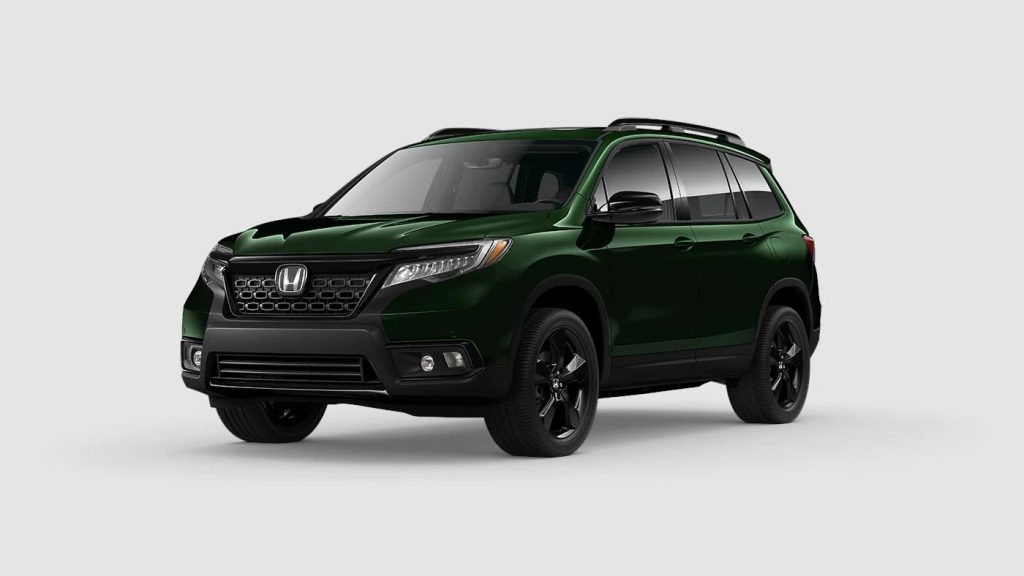 Black Forest Pearl 2020 Honda Passport on Gray Background