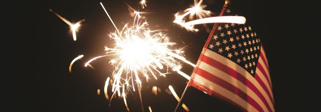 Close Up of American Flag and a Sparkler