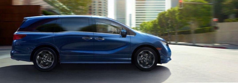 Blue 2021 Honda Odyssey Side Exterior on a City Street