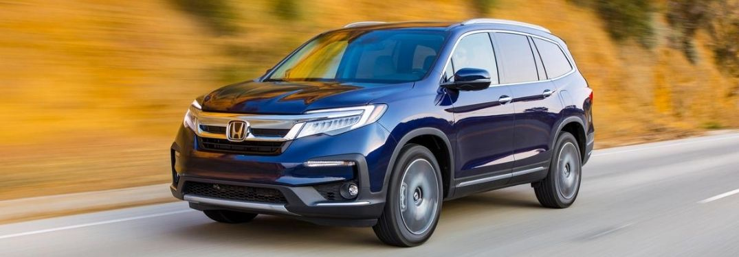 Blue 2021 Honda Pilot Driving on a Country Road