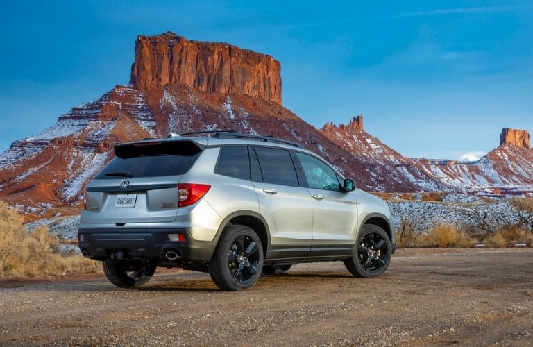 Silver 2021 Honda Passport Rear Exterior in Snowy Desert