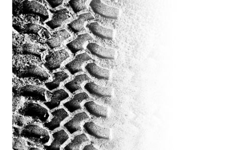 close up of tire tread in snow with untouched snow on right