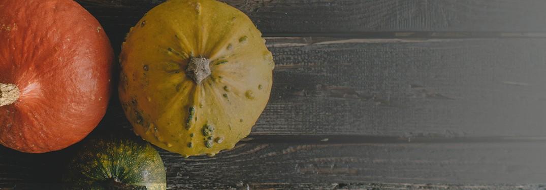 three pumpkins on wood