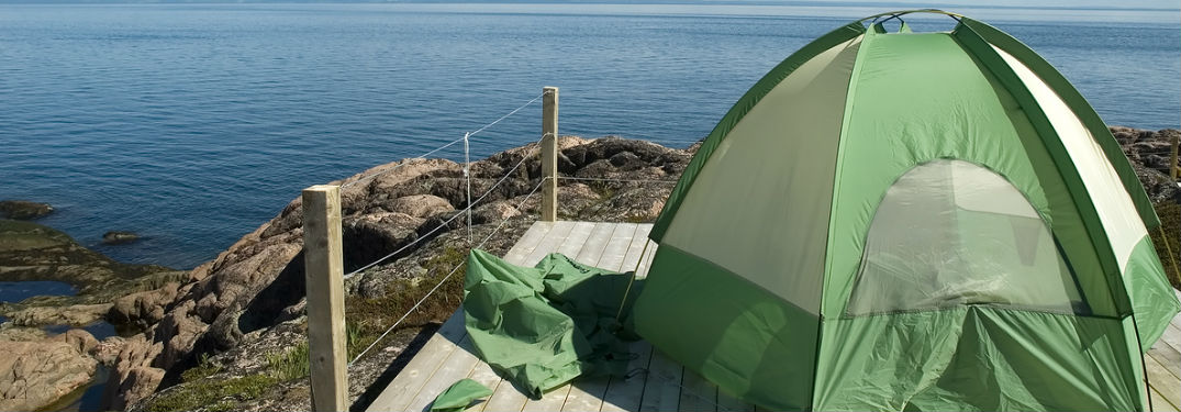 tent on a cliff overlooking water
