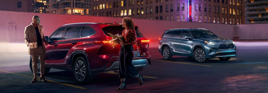 A couple entering a parked 2020 Toyota Highlander