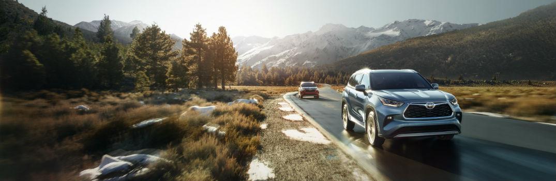 Toyota Highlander Models Traveling on Road