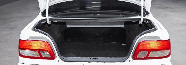 open trunk of white car empty