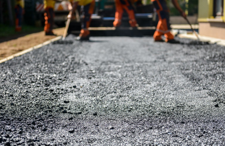 construction workers working on a road