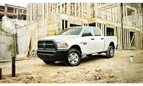 2018 Ram 1500 exterior shot with white paint color job parked in the middle of a construction site